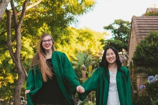2 students at graduation