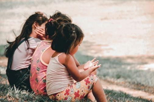 3 girls sitting in the grass